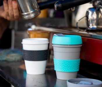 Barista At Mobile Coffee Van Using Reusable Coffee Cups