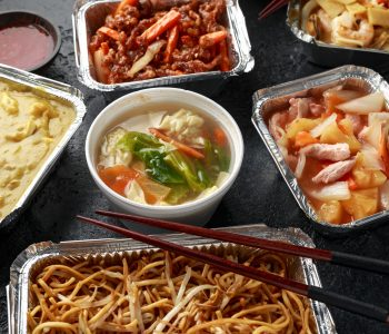 Chinese takeaway food. Pork Wonton dumpling soup, Crispy shredded beef, sweet and sour pineapple chicken, egg noodles with bean sprouts, curry